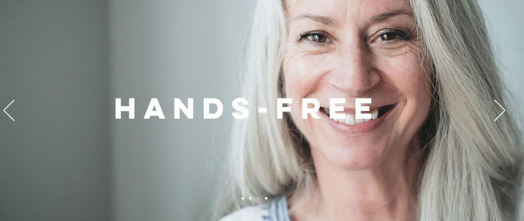 smiling woman with long grey hair with the words HANDS-FREE in bold over the top