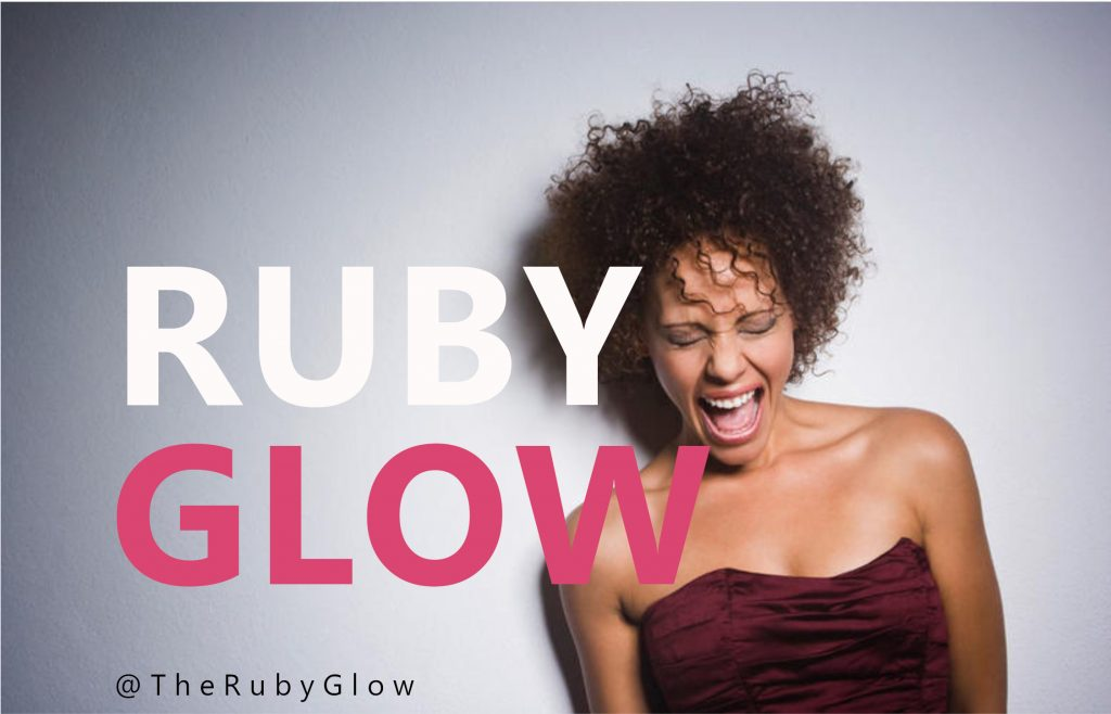 ride on vibrator ad for Ruby Glow - a woman smiles with the words Ruby Glow over her